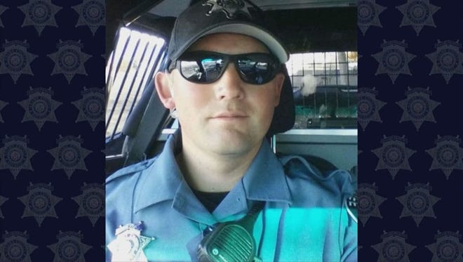 Photos of Adams County Deputy Heath Gumm shown during his funeral. The 31-year-old was shot and killed on Jan. 24 while responding to an assault call.