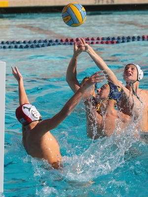 La Quinta's Spencer Lowell scores against Bonita during the CIF first round water polo match on Wednesday in La Quinta.