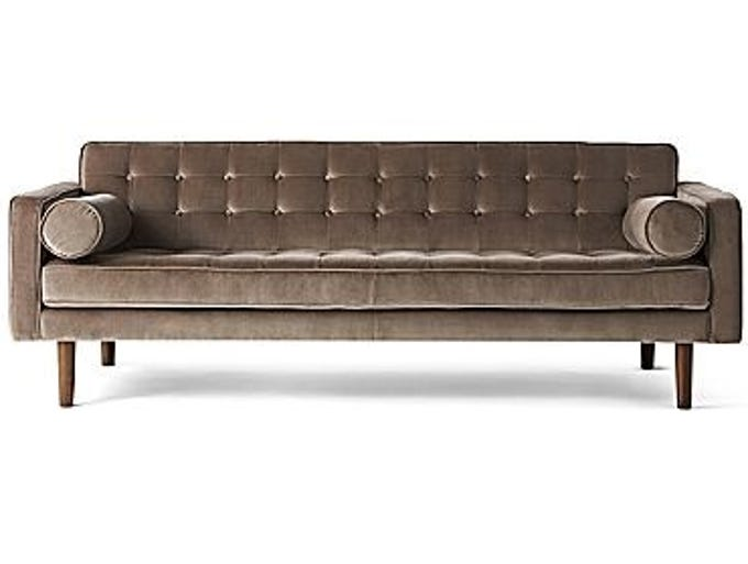 Crescent Heights tufted sofa, $1,195 (originally $3,995). This Midcentury Modern-style sofa in velvet has clean lines and comes with two bolster pillows.