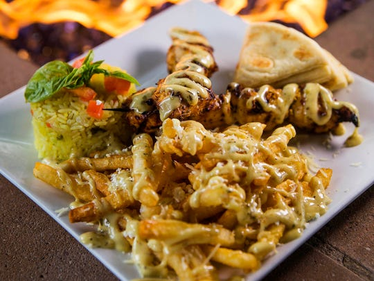 Chicken souvlaki from Opa Greek Life restaurant at Westgate in Glendale March 28, 2016.