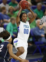 FGCU's DyTiesha Dunson passes against the University of North Florida during their Atlantic Sun tournament quarterfinal game Friday at Alico Arena in Fort Myers. FGCU beat UNF 74-35.