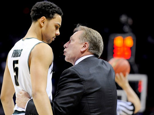 MSU head coach  Tom Izzo has a talk with player Bryn