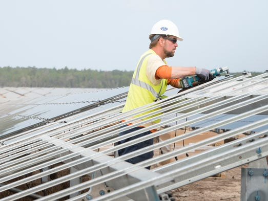 James Drane assembles solar panels at Gulf Power's