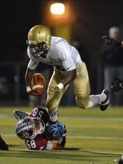 Dunmore's Luke Yanisko (bottom)  misses the tackle