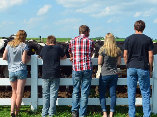 The Rahmlow children lean against the fence at the front of their farm on July 18. Each of the children work on the farm, which recently received the distinction of being a Century Farm. From left to right: Kyra, 15; Kaden, 12; Jarrod, 21; Jena, 23Trent, 18