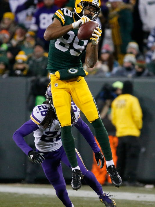 Green Bay Packers' Michael Clark leaps to make a catch during the second half of an NFL football game against the Minnesota Vikings Saturday, Dec. 23, 2017, in Green Bay, Wis. (AP Photo/Mike Roemer)
