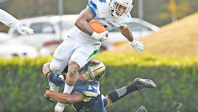 University of West Florida running back Leroy Wilson carries the ball against Wingate on Saturday in Wingate, N.C.