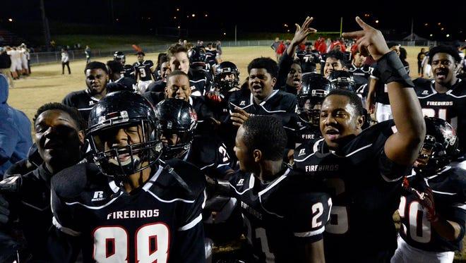 Pearl-Cohn players celebrate their win against Fairview at an high school football game Friday, Nov. 17, 2017, in Nashville, Tenn. Pearl-Cohn won 41-17.