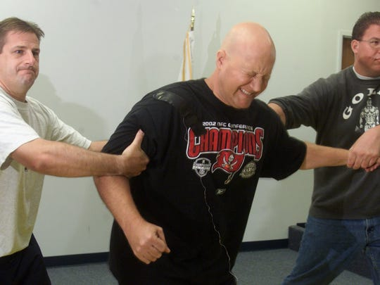 Cape Coral police officer Michael Hoesley is held up