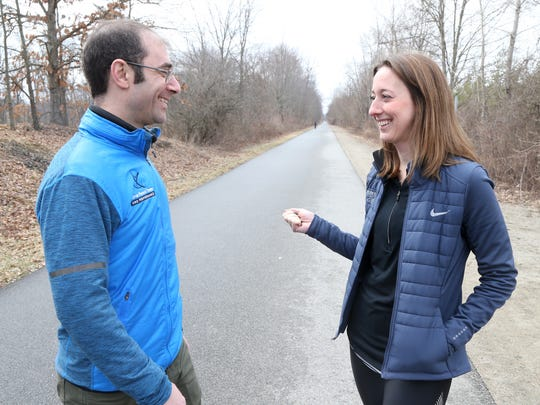 Justin Feldman of Feldman Physical Therapy and Kim Caruso of Fleet Feet Sports on the Dutchess County Rail Trail after Wednesday's announcement for the June 9 Run For Heroes.