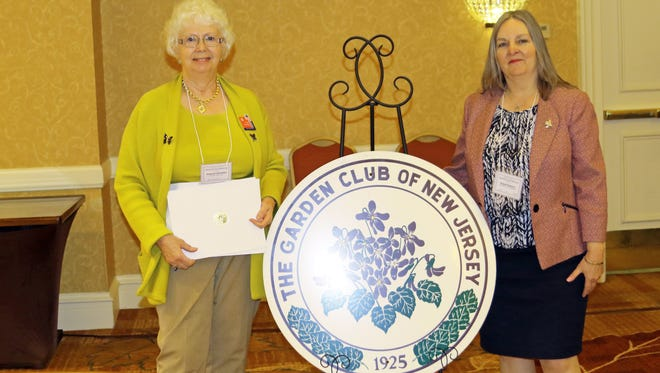 Jeannie Geremia on left and Diana Kazazis on right after accepting award for the Pollinator Center Signage Project at the GCNJ Luncheon.