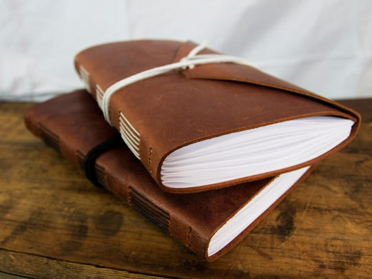 Leather journals and sketchbooks handmade by local artist Josiah Pennington are available at Grayson Home in Fordland.