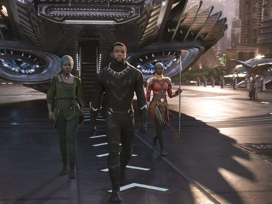 Nakia (far left, Lupita Nyong'o), T'Challa (Chadwick Boseman) and Okoye (Danai Gurira) are Wakanda's greatest protectors in 'Black Panther.'