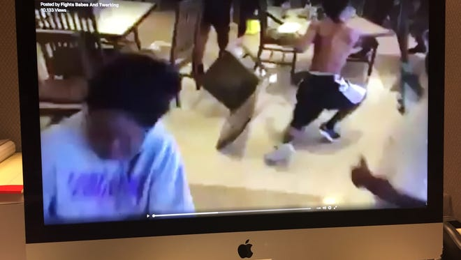 A video still is shown on a computer monitor that allegedly shows a fight on the Alcorn State University campus.