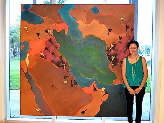 "Iranian-American artist Leila Mesdaghi and her painting ""No War With Iran"""