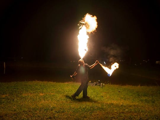 Asheville Barnaroo keeps getting bigger and bigger, featuring bands, artists, food and, pictured, a fire spinner at one of the previous festivals.