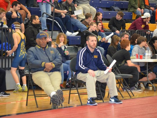 Longtime BCC coach Jeff McGinnis, left, died Monday.