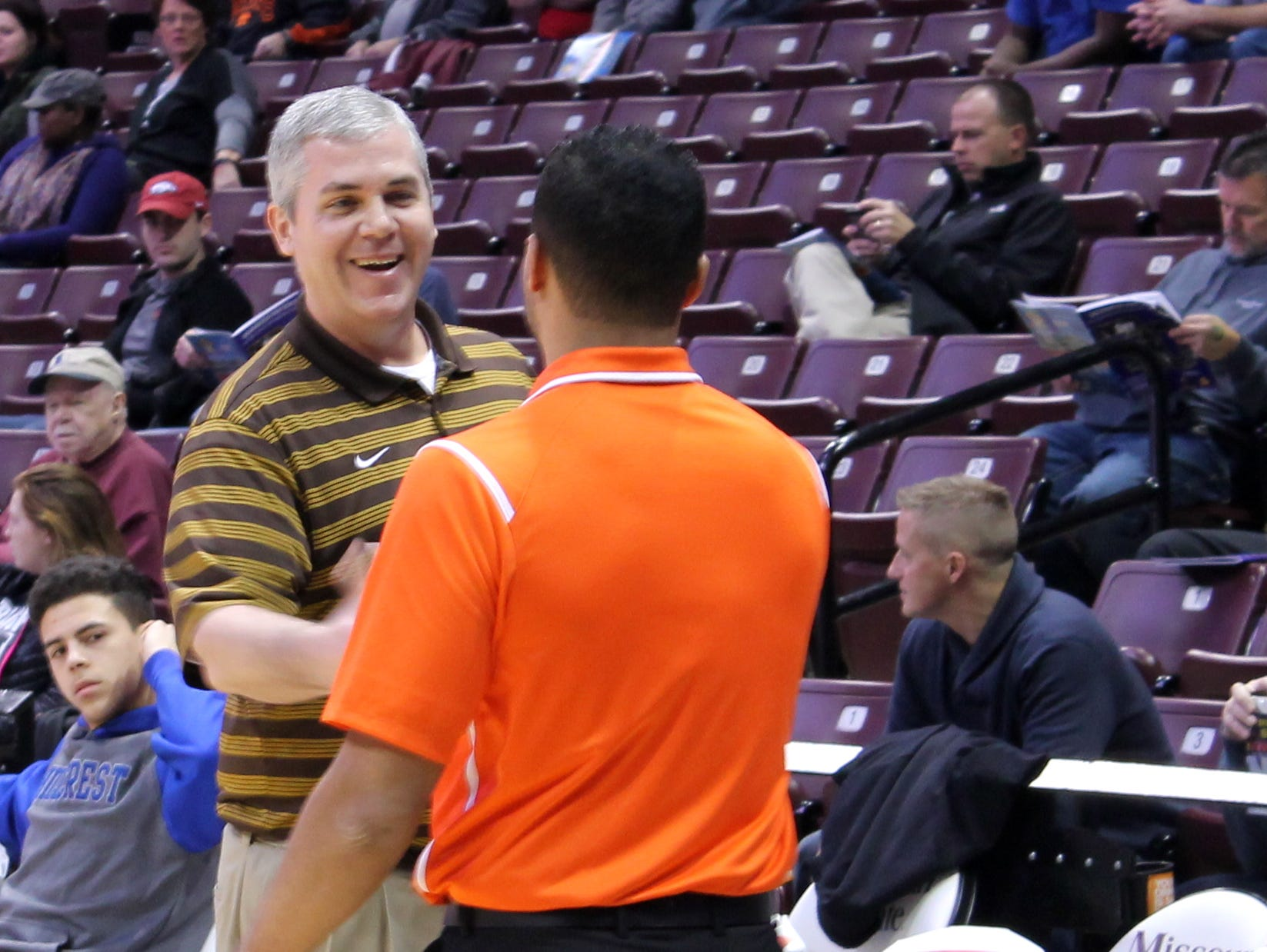 Kickapoo boys basketball coach Dick Rippee (left) shakes hands with Hillcrest Joel Brown, a former assistant of Rippee's for five seasons, prior to a Blue and Gold Tournament game between the two Springfield teams Dec. 28, 2015 at JQH Arena.