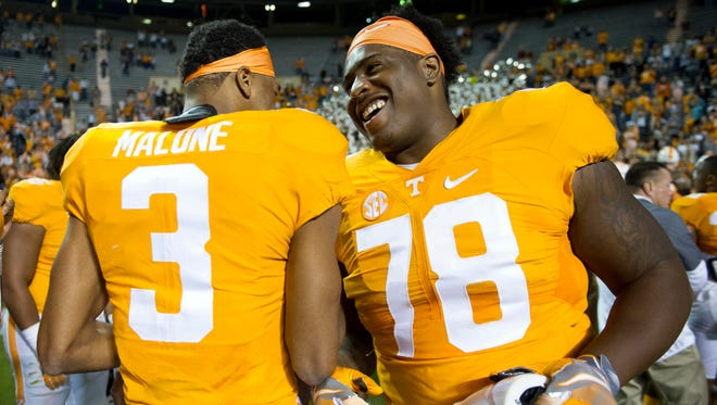 Tennessee wide receiver Josh Malone, left, and offensive lineman Charles Mosley celebrate after the Vols'  55-0 win over Tennessee Tech on Saturday at Neyland Stadium.