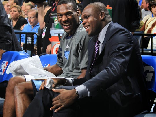 Memphis Grizzlies guard Tony Allen, left, shares a laugh with Memphis Grizzlies forward Zach Randolph, right, in the first half of an NBA basketball game on Monday, Jan. 16, 2012, in Memphis, Tenn. This was the first game Randolph was in attendance since tearing a ligament in his right knee.  (AP Photo/Nikki Boertman)