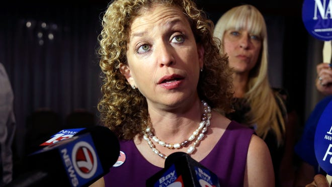 FILE - In this Aug. 26, 2014 file photo, Democratic National Committee Chairwoman, Rep. Debbie Wasserman Schultz, D-Fla.  speaks to the news media in Weston, Fla. Democrats are turning to Kentucky Gov. Steve Beshear, Google executive chairman Eric Schmidt and others to lead a task force to address problems in recent midterm elections. The Democratic National Committee on Thursday named a 10-person panel to examine the party's struggles during the 2014 and 2010 elections and recommend solutions. It aims to figure out why Democrats have struggled to turn out core voters in nonpresidential races and will examine its tactics, messaging and get-out-the-vote operations. (AP Photo/Lynne Sladky, File) ORG XMIT: WX303