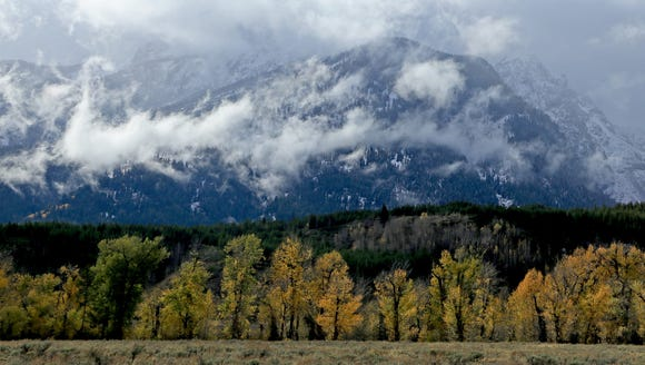 Clouds float past the Teton Range in Wyoming's Grand