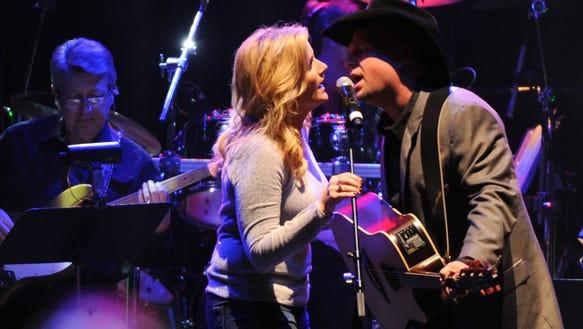 "Garth Brooks and Trisha Yearwood perform ""Take Me"""