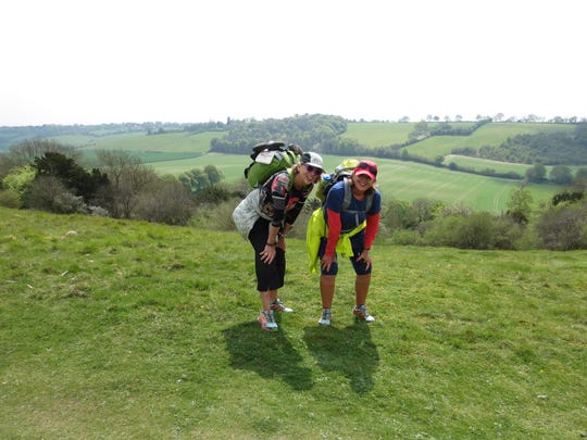 Caroline Maxwell and her sister Candace Wagner take a break at the top of Ridgeway National Trail in England.
