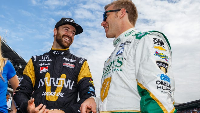 May 27, 2016; Indianapolis, IN, USA; IndyCar Series driver James Hinchcliffe (left) with Ed Carpenter during Carb Day for the Indianapolis 500 at Indianapolis Motor Speedway. Mandatory Credit: Mark J. Rebilas-USA TODAY Sports