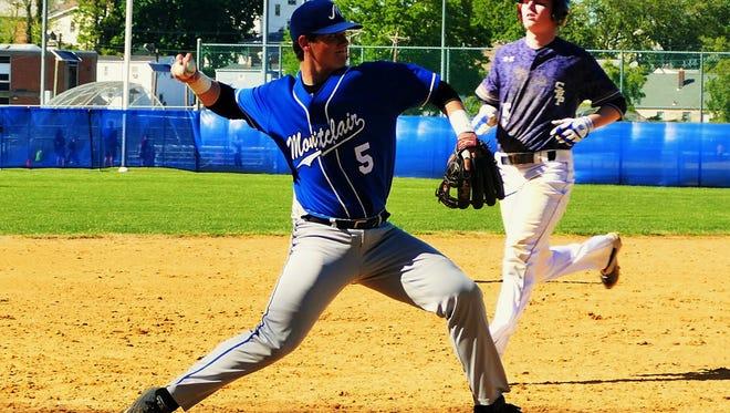 Matt McGoey making a throw at third base for Montclair against Seton Hall Prep.