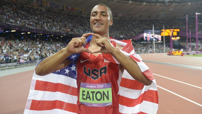 Aug 9, 2012; London, United Kingdom; Ashton Eaton (USA) celebrates after winning the gold in the decathlon during the London 2012 Olympic Games at Olympic Stadium. Mandatory Credit: Kirby Lee-USA TODAY Sports