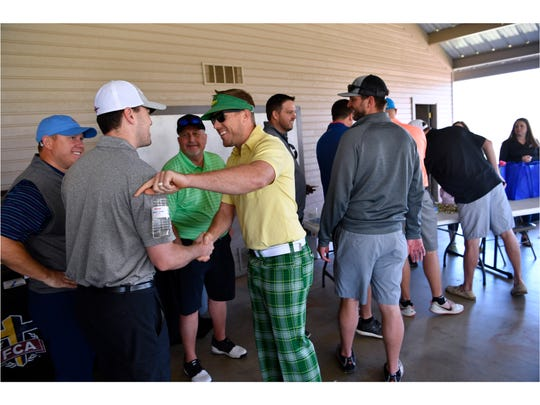 Denver Broncos starting quarterback Case Keenum greets golfers Friday March 30, 2018 at Diamondback Golf Club during the Big Country Fellowship of Christian Athletes Golf Tournament. Keenum, an Abilene native, played quarterback for Wylie High School from 2003-2005, winning the state championship in 2004.