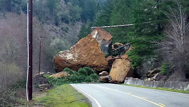 Rocks as large as 40 feet by 40 feet crashed down onto Tyee Road on Tuesday, February 16, 2016.