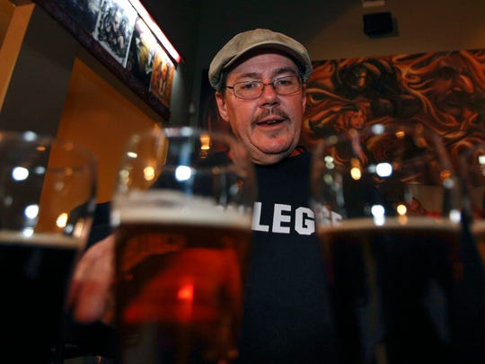 Co-owner of the New Albanian, Roger Baylor, discusses some of the craft beers his establishment serves.    Feb. 6, 2015