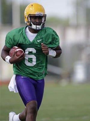 LSU quarterback Brandon Harris works out during a team practice earlier this month.