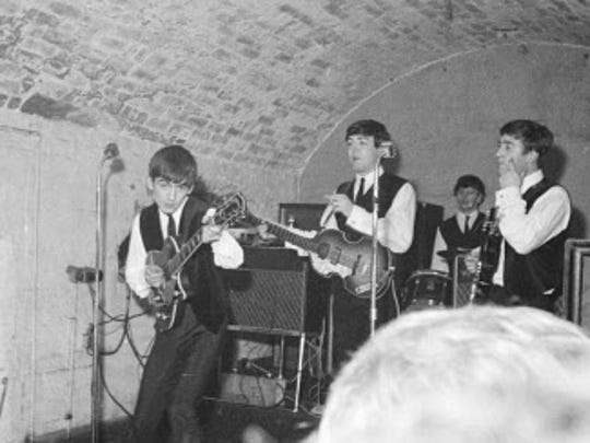 The Beatles performing at the Cavern Club in Liverpool