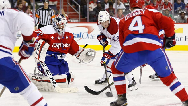 Montreal Canadiens left wing Daniel Carr (43) scores a goal on Washington Capitals goalie Braden Holtby (70) in the second period at Verizon Center.