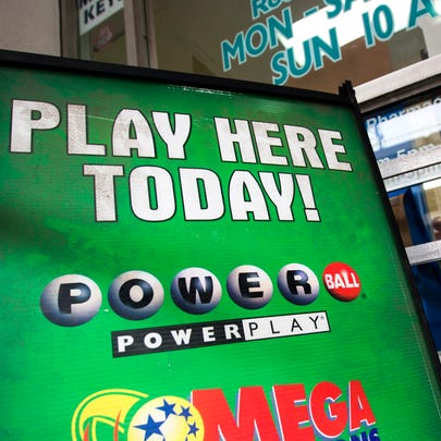 A sign for the multi-state Powerball lottery is pictured