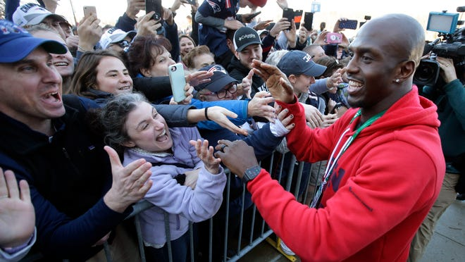 New England Patriots free safety Devin McCourty, right, greets fans following the football teams arrival at Gillette Stadium, Monday, Feb. 4, 2019, in Foxborough, Mass, after defeating the Los Angeles Rams Sunday in NFL Super Bowl 53, in Atlanta, Ga.