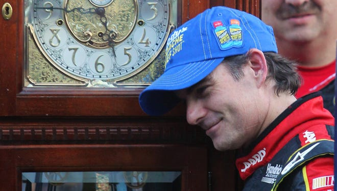 Jeff Gordon with the grandfather clock he won after winning the Goody's Fast Relief 500 at Martinsville Speedway.