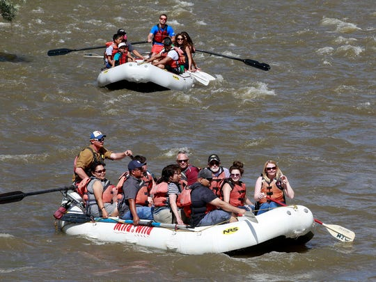 Visitors to Riverfest head down the Animas River on