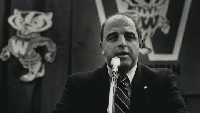 Barry Alvarez speaks with the media after being named UW's new football coach in 1990.