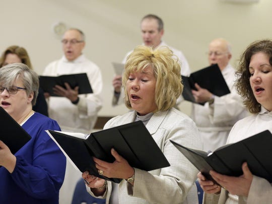 Jennifer Johnson (center) rehearses with the choir at First English Lutheran Church in March.