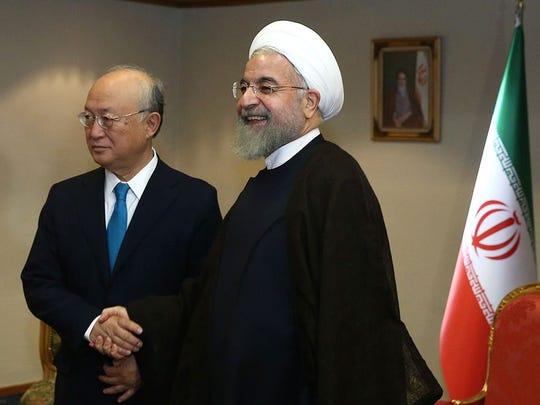 Iran's President Hassan Rouhani, right, met with  the