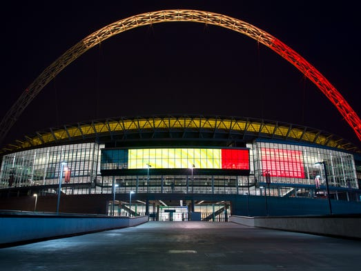 The arches of Wembley Stadium are illuminated with