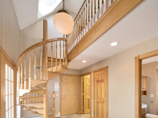 The spiral staircase gives the home an modern feel.
