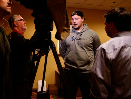 Justin Britt speaks with the media at the University Plaza in Springfield on April 8, 2014.