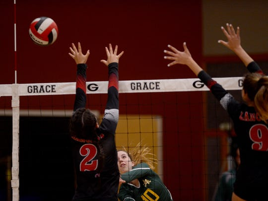 La Reina's Jenna Matus (middle) makes a kill past Grace