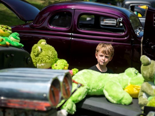 Nate Garrett, 4, of Evansville, looks at the stuffed animals decorating cars at the 43rd Annual Frog Follies at the Vanderburgh County 4-H Center on Saturday, August 26, 2017.