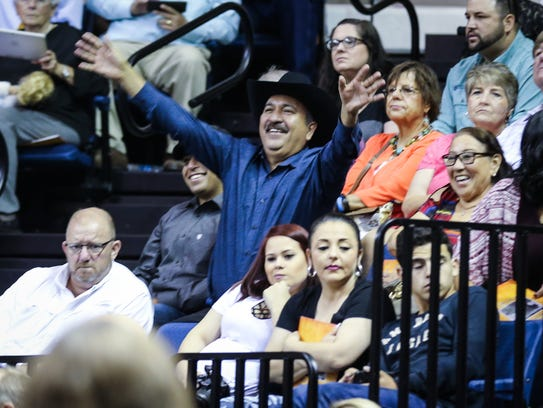 Families of Central students wave at their grads during